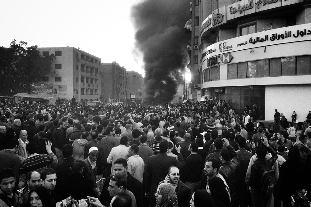 """PHOTO JOURNALISM - """"A CAR IS ON FIRE – MANSOURA, EGYPT"""" - Chaoyue Pan"""