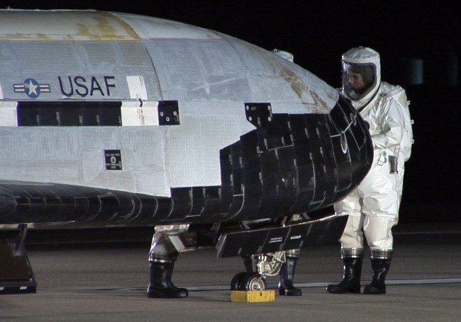 The_X-37B_OTV_is_inspected_after_landing_at_Vandenberg_Air_Force_Base,_California