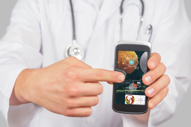 Man doctor is pointing on mobile phone space for text
