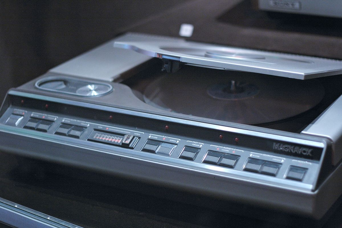 """Magnavox Laserdisc player"" by Marcin Wichary from San Francisco, U.S.A. - LaserdiscUploaded by Edward. Licensed under CC BY 2.0 via Commons."