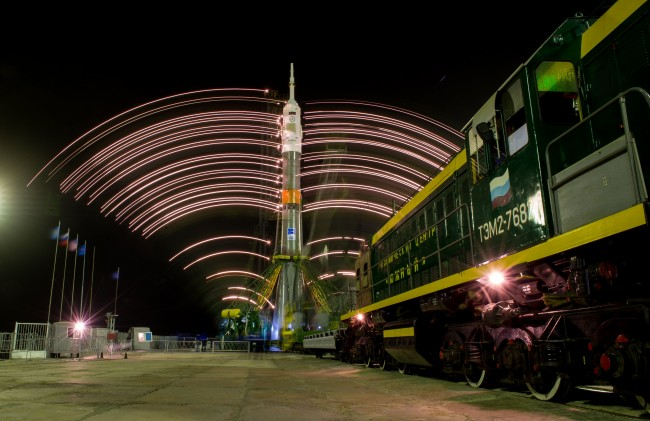The gantry arms close around the Soyuz TMA-20M spacecraft to secure the rocket, as seen in this long exposure photograph taken on Wednesday, March 16, 2016 at launch pad 1 at the Baikonur Cosmodrome in Kazakhstan. Launch of the Soyuz rocket is scheduled for March 19 and will carry Expedition 47 Soyuz Commander Alexey Ovchinin of Roscosmos, Flight Engineer Jeff Williams of NASA, and Flight Engineer Oleg Skripochka of Roscosmos into orbit to begin their five and a half month mission on the International Space Station. Photo Credit: (NASA/Aubrey Gemignani)