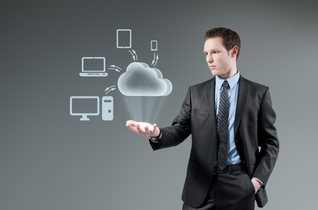 Cloud computing idea concept. Man holding cloud Hologram.